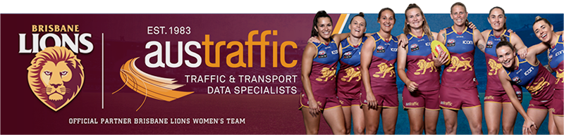 photograph of brisbane lions aflw team and Austraffic sponsor logo
